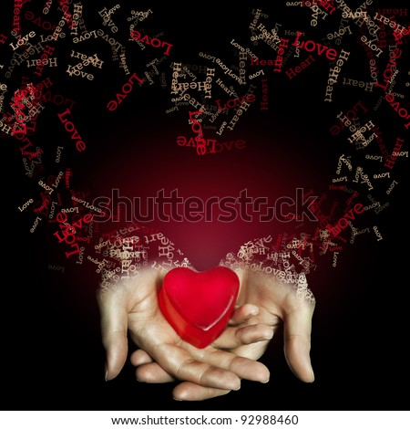 Red heart in hand on black background. love and heart. love concept. - stock photo