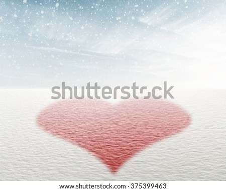 Red heart in winter landscape, valentine background - stock photo