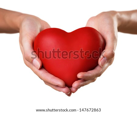 red heart in woman's palms isolated on white background  - stock photo