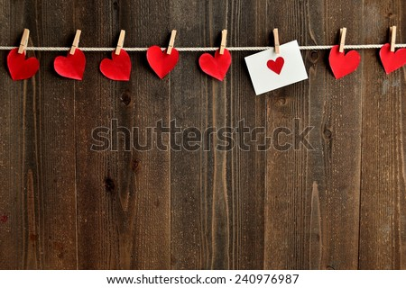 Red heart message card and red heart paper cut out with clothes pins.Image of Valentines day. - stock photo