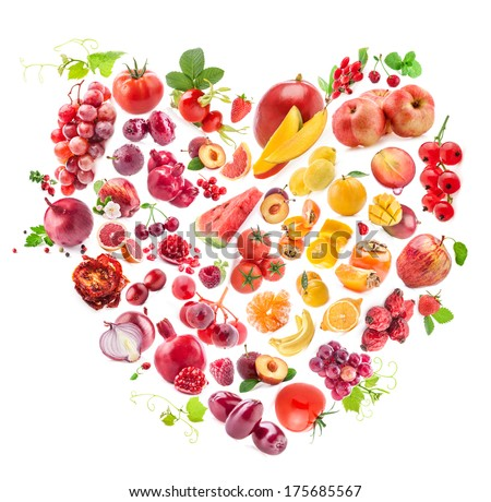 Red Heart of fruits and vegetables isolated on white - stock photo
