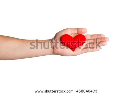 Red heart on a hand isolated on white background. A red heart to give someone to show that you love him or her so much. Valentine's day theme. - stock photo