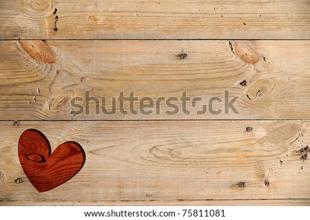 Red heart on a wooden table - stock photo