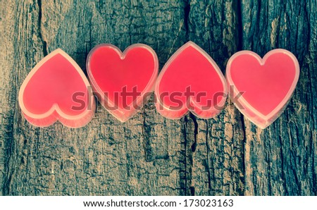 Red heart on old wood. - stock photo