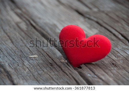 Red heart on old wooden background - stock photo