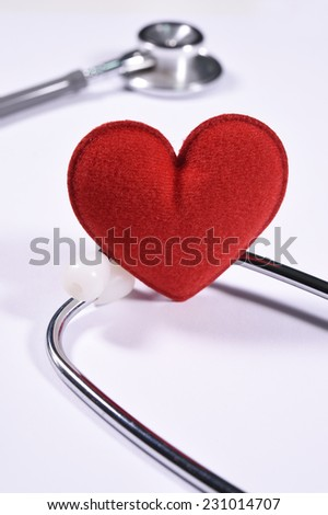 Red heart on stethoscope isolated white background. - stock photo