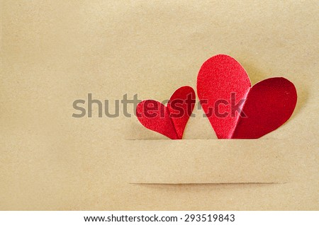 Red heart on vintage brown paper background with copy space - stock photo