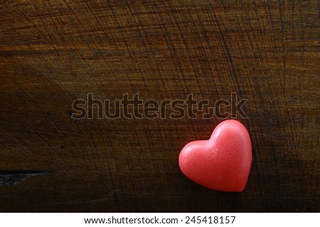 Red heart on wooden background for valentine's day or greeting card - stock photo