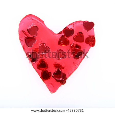 Red heart shaped jello filled with heart shaped confetti on white background - stock photo