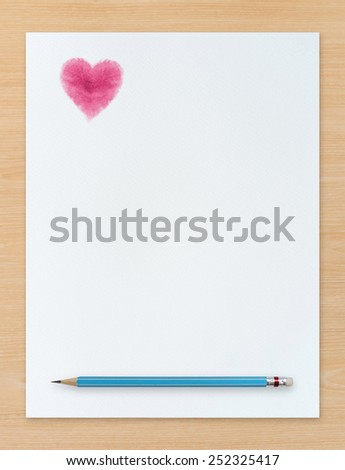 """Red heart symbol and blue pencil on white paper background on wood. Abstract background for """"valentines day"""" and wedding card. - stock photo"""