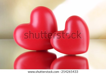 Red hearts on light background - stock photo