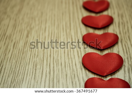 Red hearts on wooden background. - stock photo
