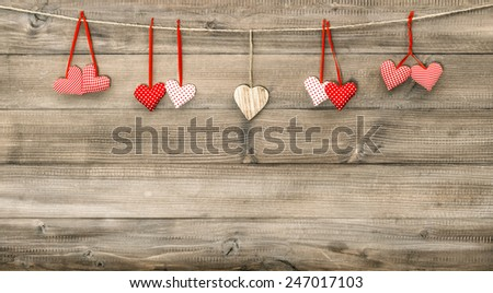Red hearts on wooden background. Valentines Day decoration - stock photo