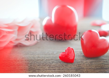 red hearts on wooden board for valentines day - stock photo