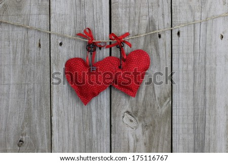 Red hearts with iron keys hanging on clothesline with wood background - stock photo