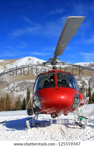 Red helicopter in the Utah mountains, USA. - stock photo