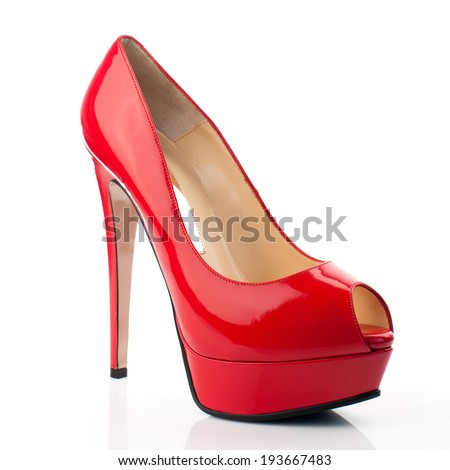 Red high heel women shoes on white background.Please, look for more photos like this in my sets. - stock photo