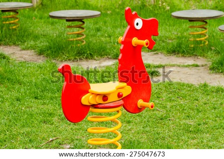 red horse playground equipment - stock photo