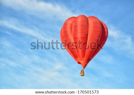 Red Hot Air Balloon in the air - stock photo