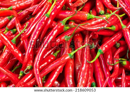 Red hot chili arrange in a row texture, background - stock photo