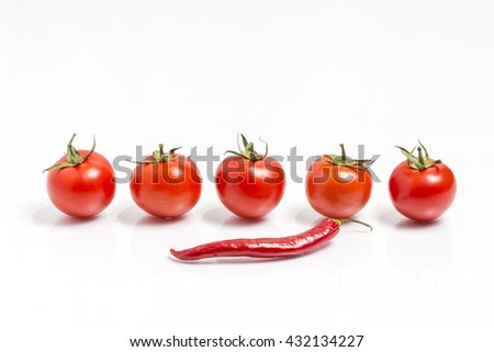 Red hot chili pepper and a bunch of fresh red tomatoes, isolated on white - stock photo