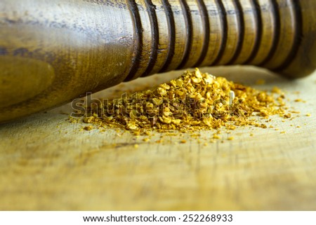 Red hot chilli pepper flakes and grinder - stock photo