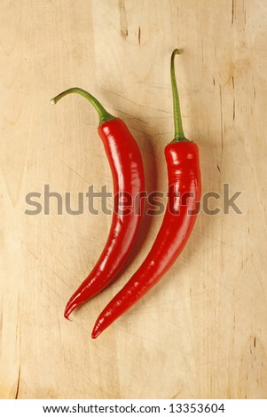 Red hot chilli peppers on a cutting board - stock photo