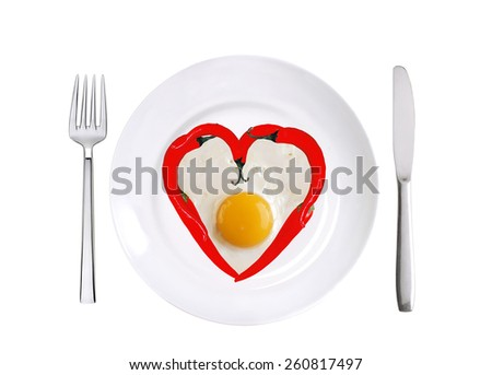 red hot chilly peppers and fried egg on white plate isolated on white background - stock photo