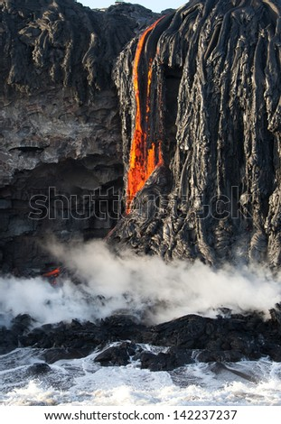 Red hot lava fall entering ocean, Big island, Hawaii - stock photo