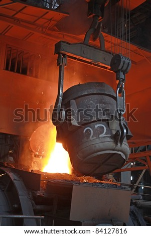 red-hot molten steel in a iron and steel enterprise production scene - stock photo