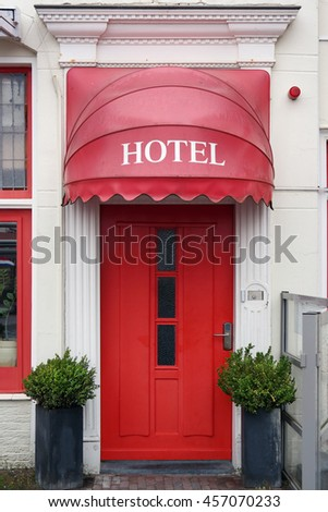 Red Hotel entrance with red Canopy as Hotel sign. - stock photo
