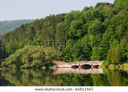 Red House Lake, bridge and forest - stock photo