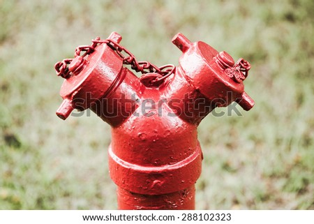 Red hydrant in vintage tone - stock photo
