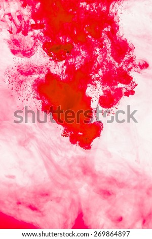 Red ink in water background - stock photo