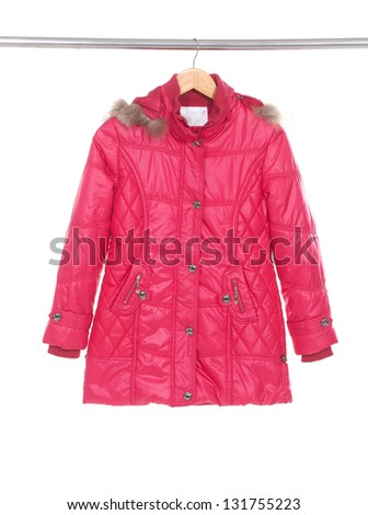 Red jacket hanging on hanger - stock photo
