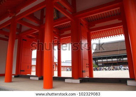 Red japanese gate into the imperial palace of Kyoto - stock photo
