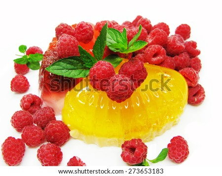 red jelly marmalade dessert with raspberry - stock photo