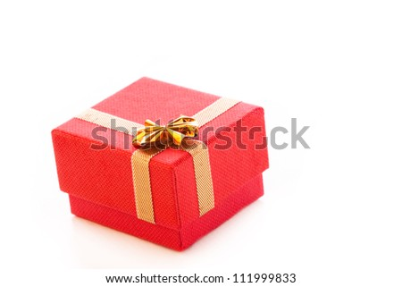 red jewelry box with gold ribbon on white background - stock photo