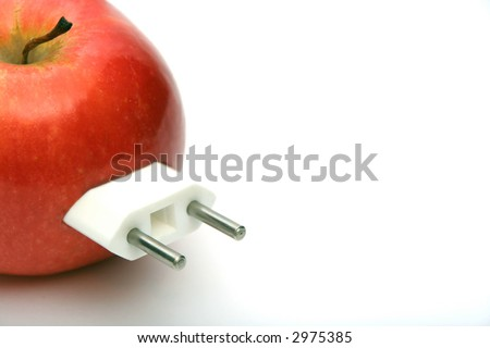 red juicy apple with 	unnecessary electricity connector - stock photo