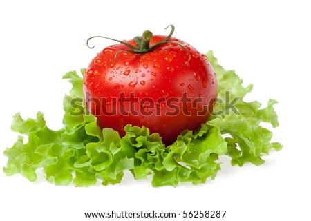 red juicy tomato with litho of the salad on white background - stock photo