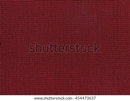Red knitted texture background close up. - stock photo