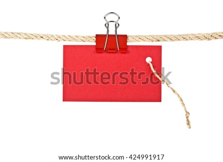 Red label on a rope isolated on white background, closeup - stock photo