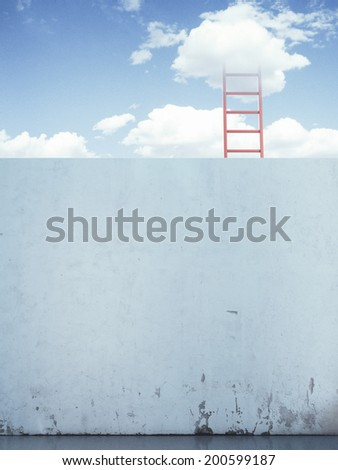 red ladder in the sky behind the wall.  - stock photo
