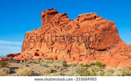 Red landscape of the Nevada desert at Valley of Fire State Park, USA. Valley of Fire State Park is the oldest state park in Nevada, USA and was designated as a National Natural Landmark in 1968. - stock photo