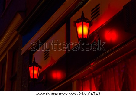 Red lanterns on the wall in Red Light District in Amsterdam, Netherlands - stock photo