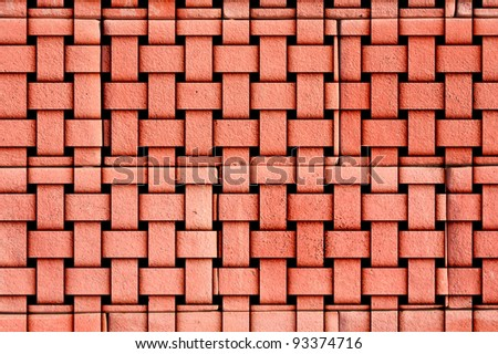 Red laterite wall weave. - stock photo