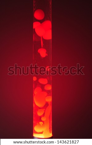Red lava lamp at night. Studio shot, isolated in darkness - stock photo