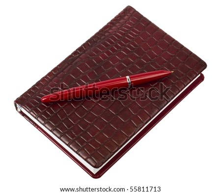 red leather diary with pen - stock photo