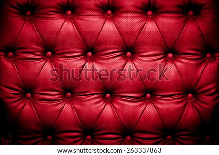 Red leather texture background with buttoned pattern - stock photo
