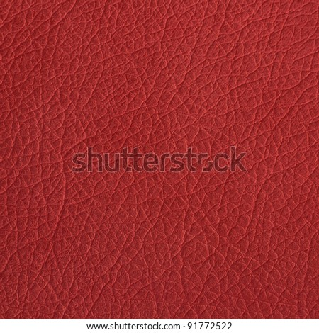 Red leather texture closeup, useful as background - stock photo